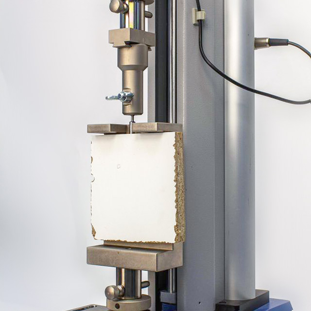 Bespoke tensile testing fixture for tensile strength of dowel in particle board
